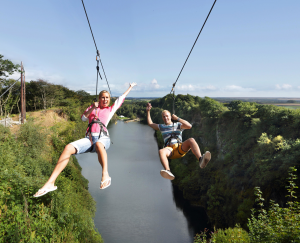 Two people on a zipwire